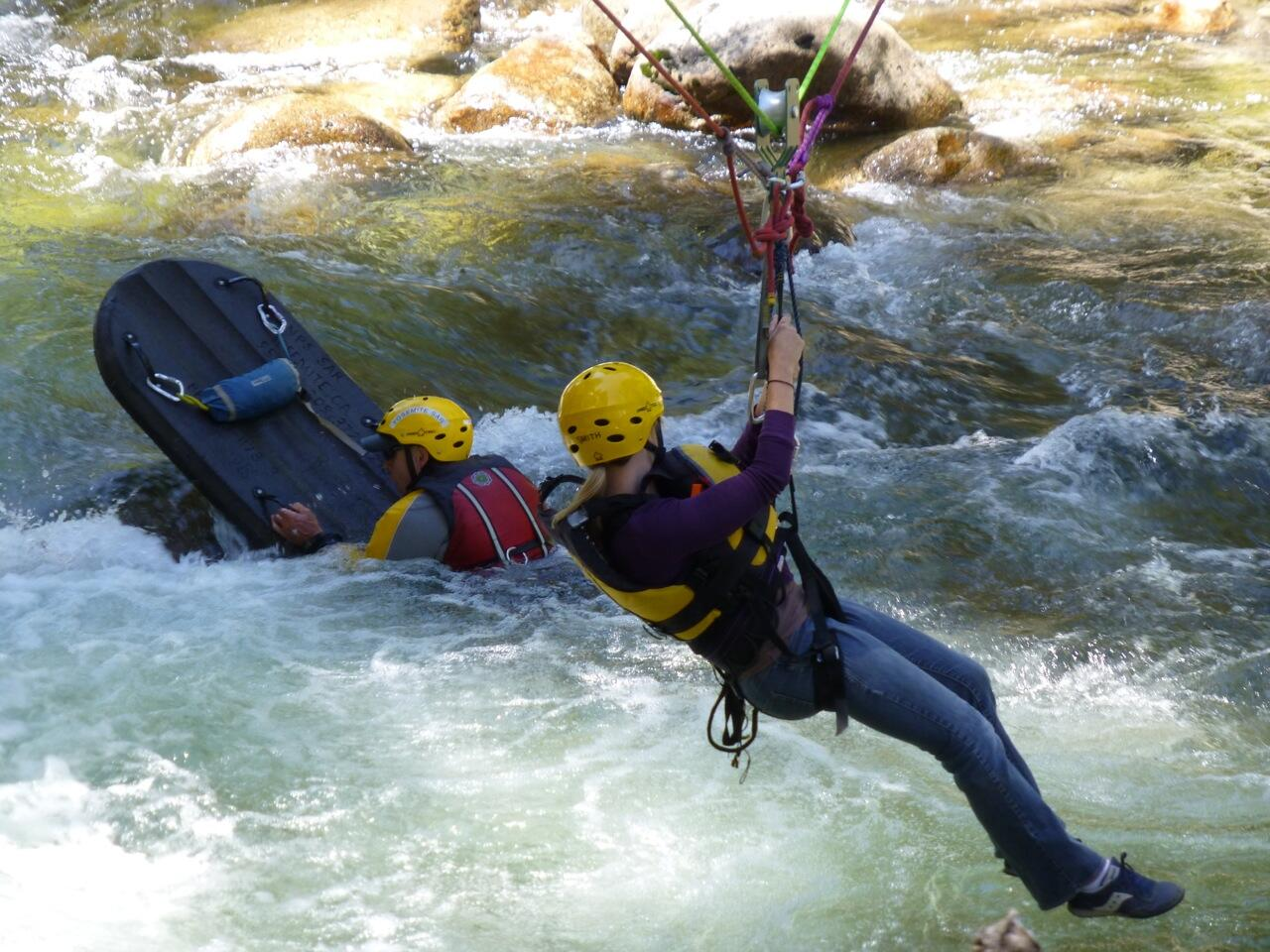 """Yosemite Park Rangers & Search and Rescue personnel demonstrate """"highline"""" rescue techniques on the Merced River http://t.co/doeXCqcaW8"""