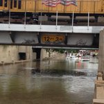 Crazy flood happening right now- Tops of three cars in the underpass between Southtown and Roosevelt Park. http://t.co/WfspQ5lNuc