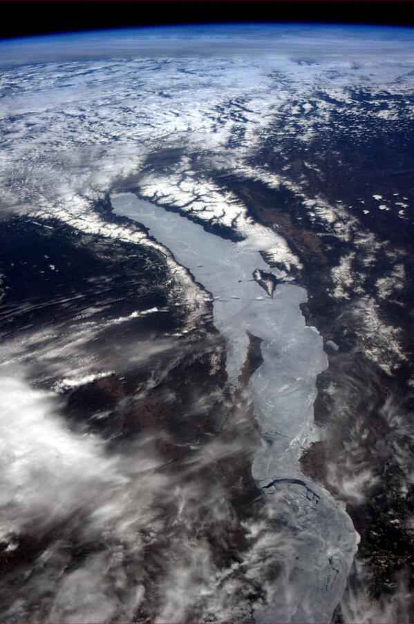 Lake Baikal, Siberia, immensely deep, ancient waters, locked under late winter ice. http://t.co/DVNSJfE7K0