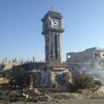 PHOTO: #Syria's flag on clocktower - @bbclysedoucet visits strategic town  #Qusair, taken by government troops