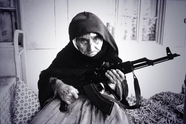 106-year-old Armenian woman sitting outside her home guarding it with an Ak-47 in the village of Degh, Azerbaijan http://t.co/BHacDsgPVi