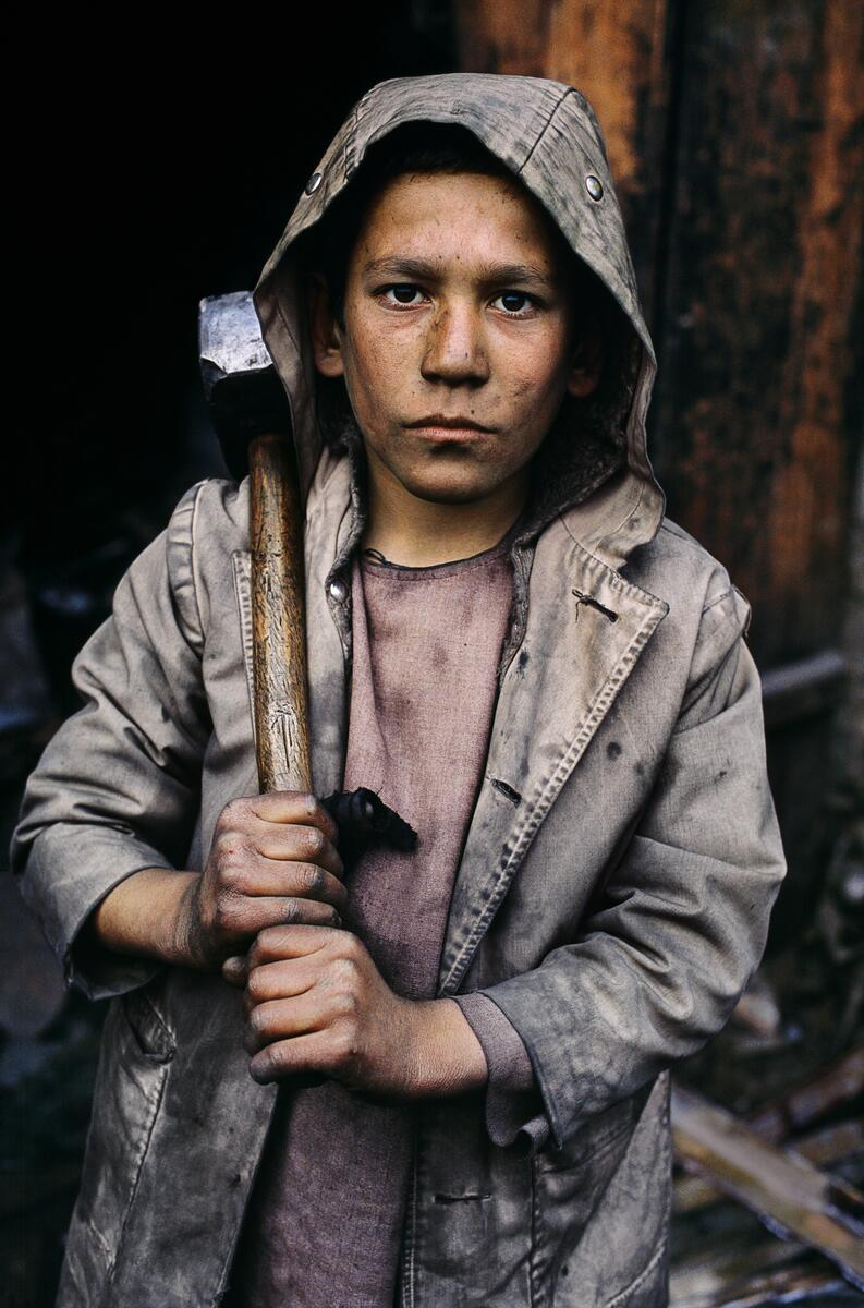 Today's photograph pictures a young miner in Charikar, Afghanistan http://t.co/gAoOsiVjFr