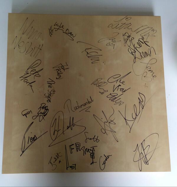 Holla, our star prize is here! A table signed by all our 2013 artists. Want it? It nice.. RT & follow by 10am on Mon. http://t.co/dB2BMReRTK