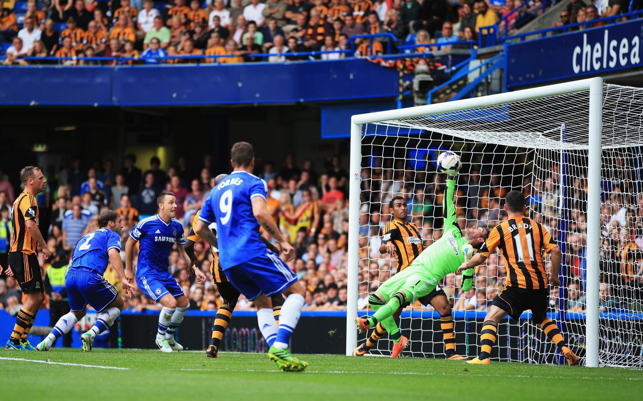 PHOTO Hull keeper Allan McGregor makes a fine save to deny Chelsea's Branislav Ivanovic just before half-time #CHEHUL http://t.co/anGnuouiBQ