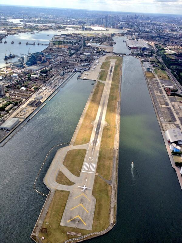 Looking towards Canary Wharf with @LondonCityAir in the foreground and @excellondon on the top right! http://t.co/1gz1Xk9NVl