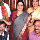 Can anyone recognise who is under d caring palms of SushmaJi. So that's the scene