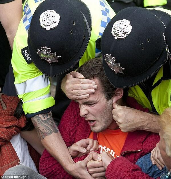 http://t.co/cosusf1gGS This really does sum up UK today - #Peaceful #Protestor #OLSX  #GE2015 #FuckTheTories @Dis_PPL_Protest @guardiannews