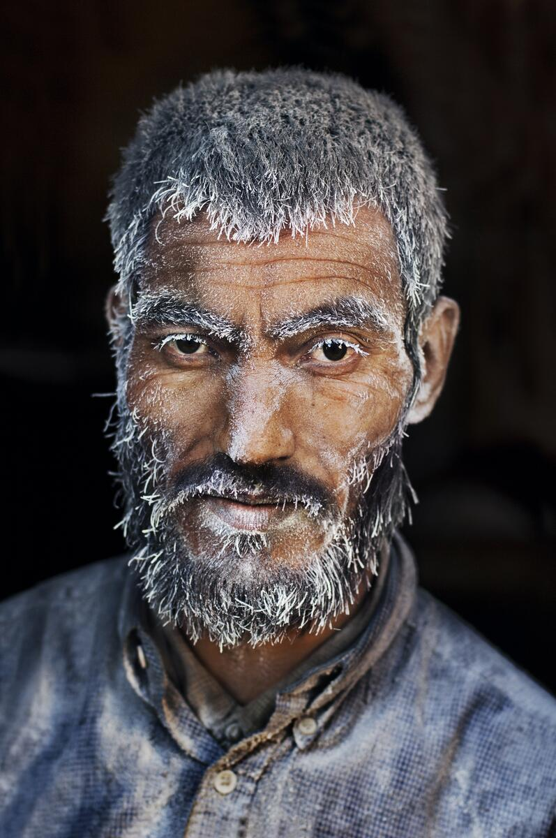 Today's photograph captures a man who works in a candy factory with sugar on his face in Kabul, Afghanistan. http://t.co/EvYoQPF7go