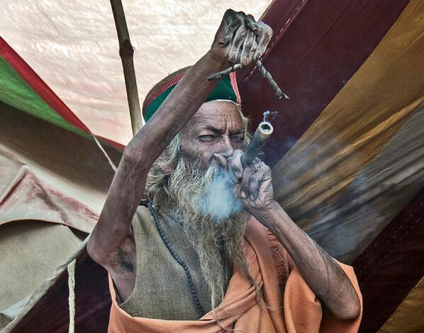 Sadhu smoking a chillum - India. He hasn't lowered his arm since 1973. http://t.co/kaaRLvbsKH