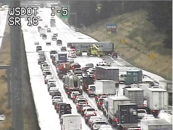 MT @wsdot_traffic: A look at the jackknifed semi on SR 18 near I-5. 2 left lanes getting through. http://t.co/IXL77O7Azh