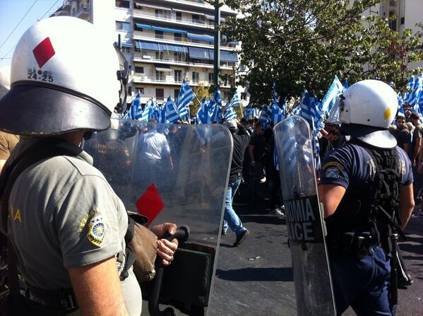 Theodora Oikonomides (@IrateGreek): Still no tear gas? Hmmmm RT @marklowen: #GoldenDawn supporters being pushed back by police into a corner. http://t.co/YGiAvpmMPC