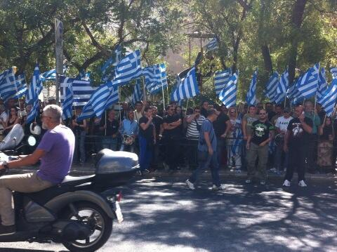 Theodora Oikonomides (@IrateGreek): No tear gas? Can't imagine why. MT @marklowen ~200 #GoldenDawn supporters outside police HQ, slogans, nat'l anthem http://t.co/jnfU2sHSup