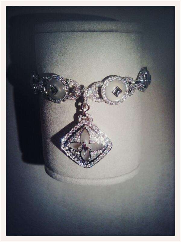 Louis Vuitton's Monogram flower is revisited as a charm, on a diamond and moonstone bracelet http://t.co/Mqnqw3nLNW #PFW