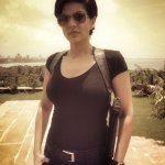 #NikitaRai #24India she wears a holster and aviators! Woot! :) http://t.co/0sKYUfCOko