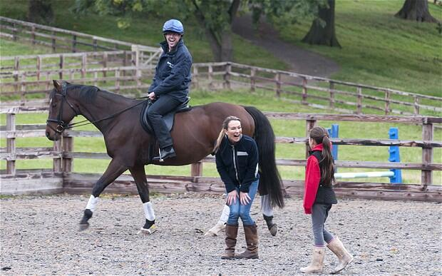 Michael Owens wife Louise got the giggles during Little Mickeys first ever riding lesson