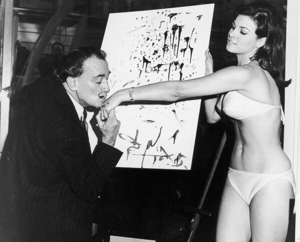 Salvador Dali Kisses The Hand Of Raquel Welch In 1965 http://t.co/y9hI9phr5K