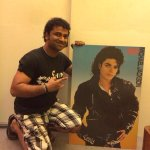 MJ poster I bot roadside wn I used 2 go 2 school by bus.Kept it safe all dese years n finaly gt it framed nw!! Like?
