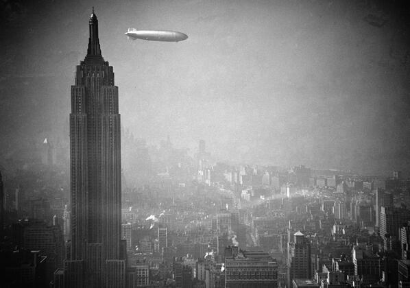 Stunning photograph of the Hindenburg floating past the Empire State Building in 1936. http://t.co/d3lCfQgRiG
