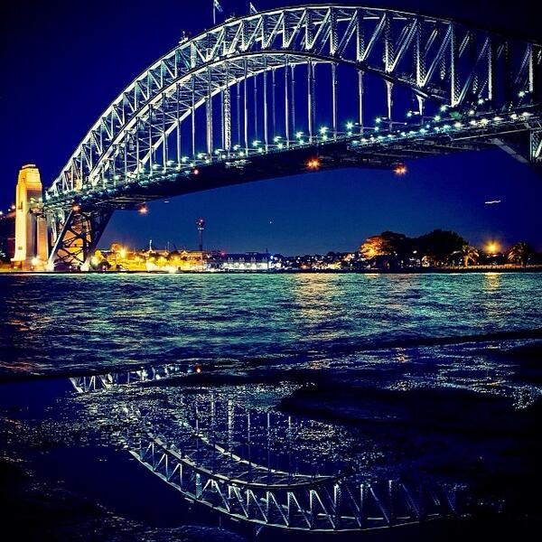 Incredible reflection of the Sydney Harbour Bridge at #night captured by @shraddhaiyerr! (via IG) http://t.co/8C3JYXjtpu