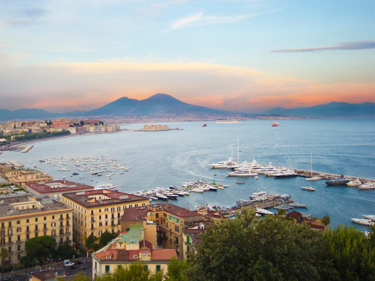 Explore the beauty of Naples, a seaside Italian city famous for its pizza -