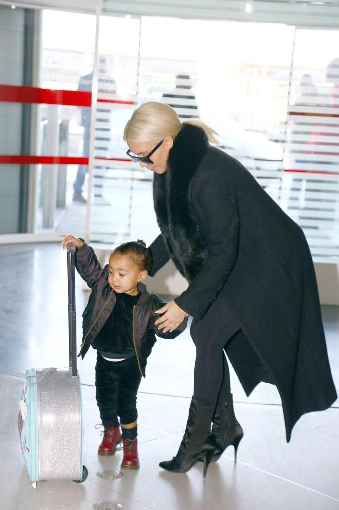 North looks so cute with her luggage at the airport. http://t.co/14O8gf6hUC