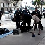 Facebook video shows LAPD shooting of homeless man during street scuffle http://t.co/oFb83Otu6w http://t.co/4DofSft2z6