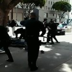 Bystanders video captures LAPD officers shooting & killing a man on the ground http://t.co/9FsP0vnan8 #LAPDShooting http://t.co/PxI3iqP5uS