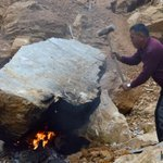 A worker crushes a boulder at a stone-mine in Kirtipur, Kathmandu. Photo: Surbindra Kumar Pun http://t.co/ygSzwFjHht