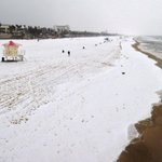 PHOTO: A blanket of hail covers the beach just south of the Huntington Beach Pier -- @alschaben #weather http://t.co/niMyjNtHOn