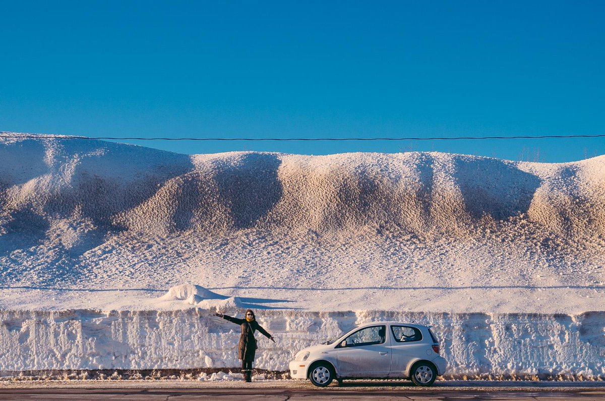 How high are the snowbanks in Moncton? Patrick Magee took this picture on Saturday in the Coliseum's parking lot. #nb http://t.co/D8yNJ3gXW1