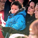 At least 150 people pay their respects to the 4 fallen RCMP officers in #Mayerthorpe tonight. http://t.co/9hgNovBB1R