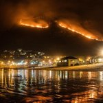 Muizenberg mountain getting consumed with fire. Photo credit: Quentin Vogel #capefire #muizenbergfire #SouthAfrica http://t.co/rF584DDQm1