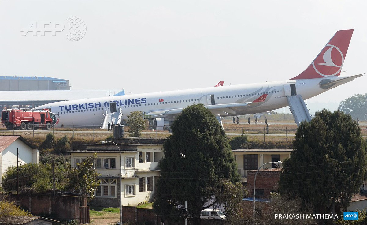 Turkish Airlines plane with 224 passengers sits on grass at Kathmandu airport after missing the runway - no injuries
