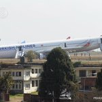 Turkish Airlines plane with 224 passengers sits on grass at Kathmandu airport after missing the runway - no injuries http://t.co/3Zsw9gyp4y