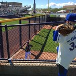 A young fan looks on as #Mariners lefty David Rollins loosens up in the pen. http://t.co/fDzN1XqGcX