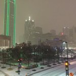Sleet has switched to snow in downtown Dallas. Large flakes falling. #wfaaweather http://t.co/dvIcnTbAhs