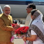 PM Shri @narendramodi being received by CM of Madhya Pradesh, Shri Shivraj Singh Chouhan at Indore Airport http://t.co/QdFU7fMoah