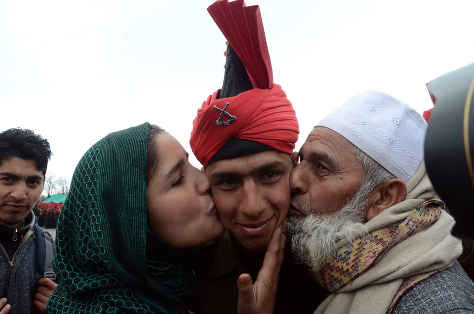 Lovely photo of overwhelmed parents kissing their son who just joined Indian Army :) http://t.co/z0VwrpCW4r
