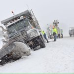A tow crew works to free a stuck plow along 15N/340W West of Mt Zion Rd Thursday morning. @frednewspost http://t.co/sD3Jo00ell