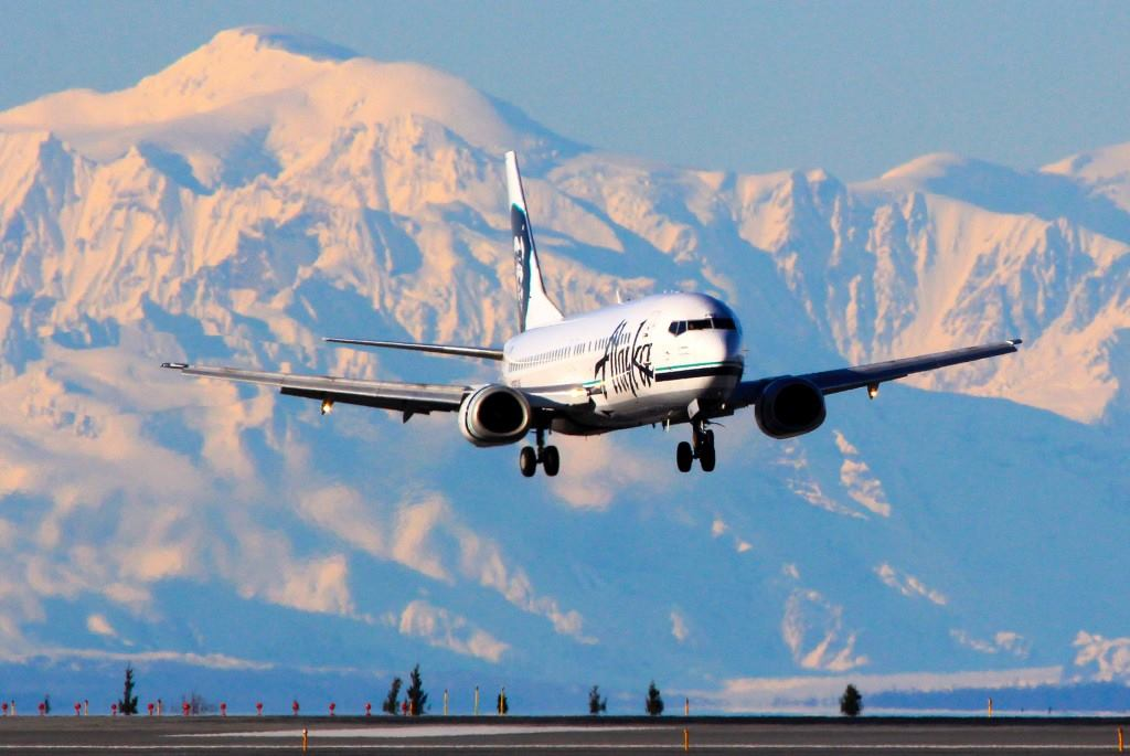 AWESOME @alaskaair photo of 737 landing in ANC. Denali is in the background. @akfotoman Photo by Rob Stapleton http://t.co/GRW13PSGWL