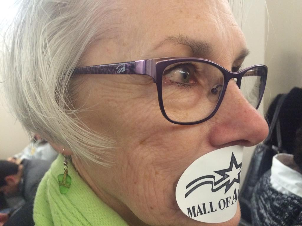 Supporters of #MOA11 silenced themselves with MOA stickers outside courtroom while the 11 faced charges. @kare11 http://t.co/NlAPUsGDPh