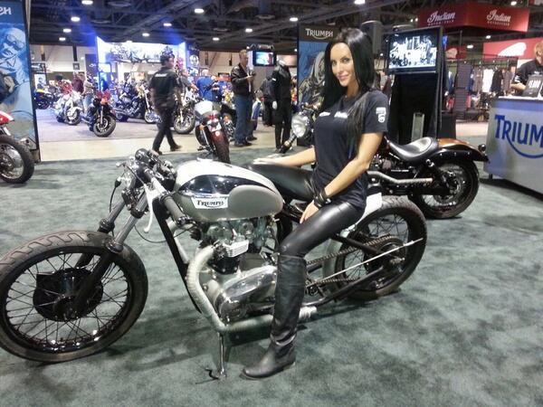 Cami on the Tony Hawk Foundation Custom Bonneville at the Long Beach International Motorcycle Show. http://t.co/XeBaQdEYhr