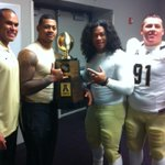 UCF players busy in the locker room getting acquainted with their new trophy #ChargeOn http://t.co/yu0S1JWBVb