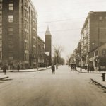 Quick, look! Happy pic time! The corner of Lark & State St with the old Eldas building to the right. pic circa 1929 http://t.co/qqOZhgnO5H