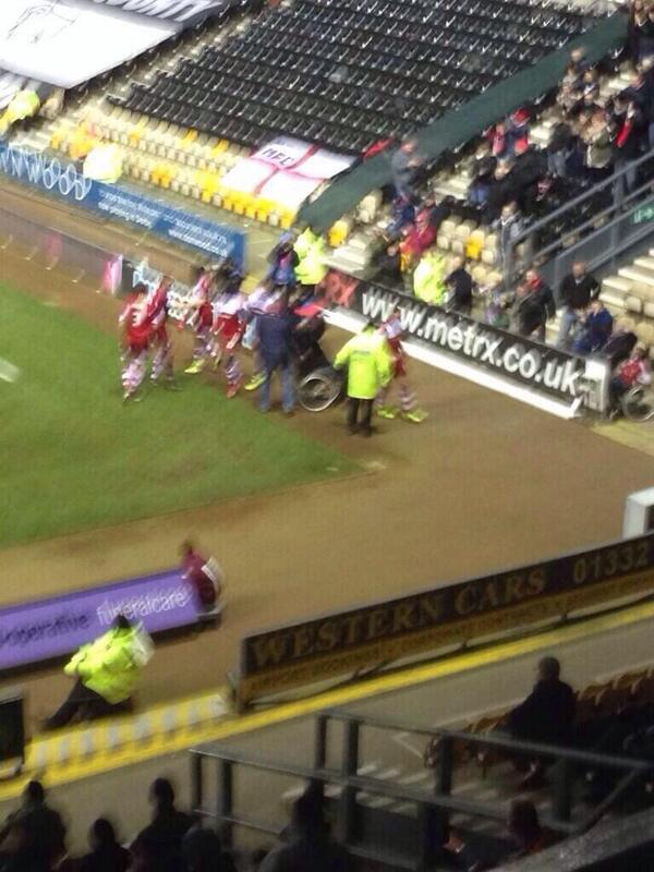 BarKfWCIEAE8Jnl Middlesbroughs players celebrated a goal at Derby with a fan in a wheelchair who invaded the pitch [Picture]