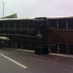RT @BBCEngland: A lorry blows over on to a car on a bridge in Newcastle-upon-Tyne http://t.co/WHh2GFWC1s http://t.co/iZkAMtrJHe