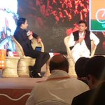Akilesh Yadav interviewed by Rahul Kanwal while Praveen Togadia looks from the audience,interesting pic #AgendaAajTak http://t.co/WMx7uJfjQp