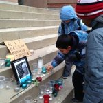 Students light candle on the steps of Nelson Mandela Park PS before class starts #CTVMandela #Toronto #TDSB http://t.co/FkDtQ34nWA
