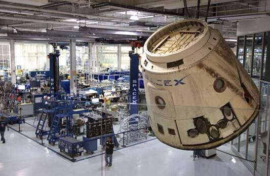 3 yrs ago today #Dragon orbited Earth for the 1st time. Same Dragon is now hanging in the rocket factory. http://t.co/hzLfM8WEVO
