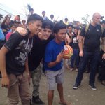 PHOTO via @SMARTCares: @JustinBieber, a basketball fan, plays basketball with Tacloban youth #GiveBackPhilippines http://t.co/uZxjXgwN5I